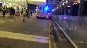 Hong Kong police chase after protesters following police vehicle vandalization at airport [Video]