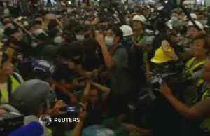 News video: Hong Kong protesters detain man claimed to be undercover police