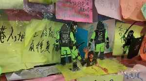 Paper Police Dolls Illustrating Protest Violence Adorn Hong Kong's 'Lennon Wall' [Video]