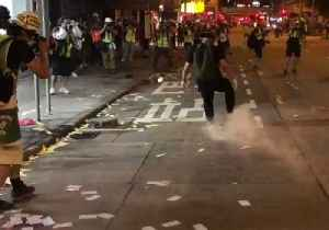 Protesters Stomp Out Tear Gas and Burn 'Ghost Money' in Hong Kong's Sham Shui Po [Video]