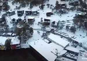 Drone Glides Over Snowy New South Wales Landscape [Video]