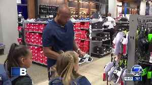 Broncos player Chris Harris Jr. goes on shopping spree with kids to help them start the new school year on the right foot [Video]