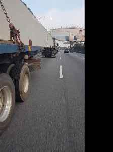 Sketchy Motorcycle Maneuver Under Semi Truck [Video]