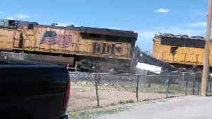 Train Takes out Car Carrier [Video]