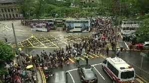 Hong Kong teachers rally in thunderstorm at start of weekend of protests [Video]