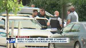 SWAT standoff ends, body found in apartment, man in custody also charged with ex-girlfriend's death [Video]