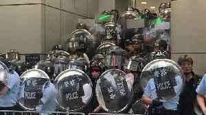 Hong Kong riot police violently shove journalist [Video]