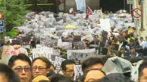 Hongkongers stage anti-government protests in the rain marking the eleventh week of demonstrations [Video]