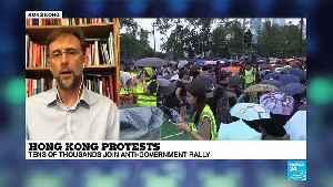 Hong Kong protesters stay peaceful as China keeps close [Video]