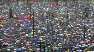 Rain fails to keep Hong Kong's protesters away [Video]