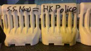 Hong Kong activists spray