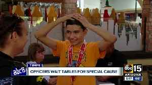 Tempe police officers wait tables Saturday for special cause [Video]