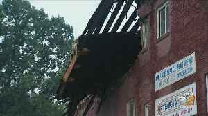 Building In Lawrenceville Falls During Microburst [Video]
