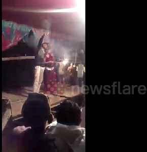 Man fires gun point-blank at Indian wedding dancer, narrowly missing her [Video]