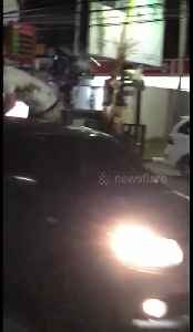 Reckless Aussie jumps onto bonnet of car, fly-kicks man on motorbike in Bali [Video]