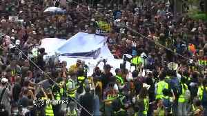 News video: Hong Kong protesters march in pouring rain