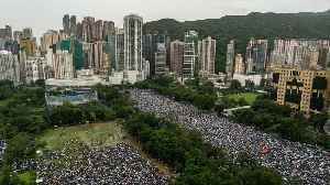 1.7 Million Protesters Marched Peacefully Through Hong Kong Sunday [Video]