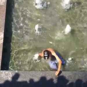 Biker Crashes Into Pond [Video]