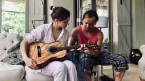 Emma Watson and first crush Tom Felton reunite for guitar lesson [Video]