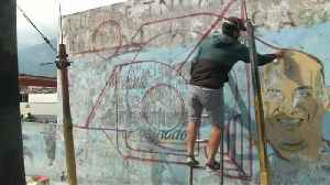 Watch: The Caracas artists reclaiming slum spaces from poverty and propaganda [Video]