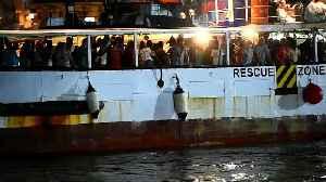 Migrants disembark Open Arms rescue ship [Video]