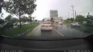 Car Causes Collision on Rainy Day [Video]