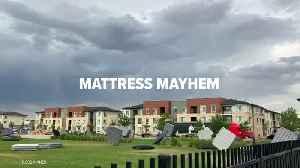 Wind Hurls Dozens of Mattresses Through Park [Video]