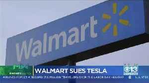 Money Watch: Walmart Sues Tesla Over Solar Panels That Caught Fire [Video]