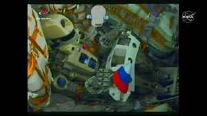 Robot clenches Russian flag during space launch [Video]