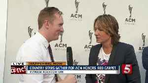 Stars walk the ACM Honors Red Carpet [Video]