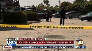 Police in standoff with man barricaded in car [Video]