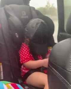Kids Sitting in Open Car Get Wet by Rain [Video]