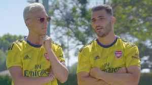 Ozil & Kolašinac...Playing Twister?! | Retro Games with Arsenal [Video]