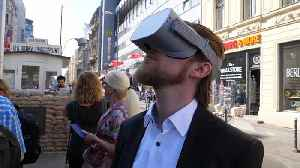 Watch: Visitors step behind the Iron Curtain with VR tour of East Berlin [Video]