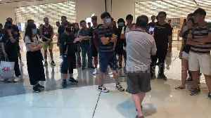 Row erupts outside Hong Kong Apple Store between protesters and resident [Video]