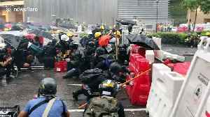Hong Kong protesters take cover behind barricades as police fire tear gas [Video]