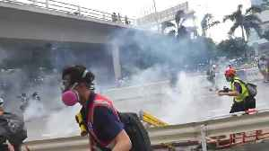 Hong Kong police baton-charge protesters In Ngau Tau Kok district during latest protests [Video]