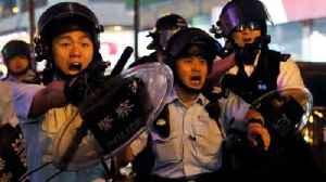 Hong Kong police draw handguns during clashes [Video]