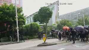 Hong Kong protesters cut down smart lampposts [Video]