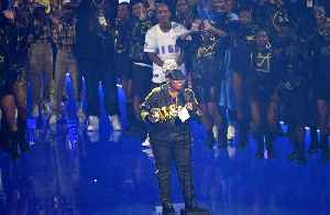 News video: Missy Elliott tries not to cry as she collects MTV Video Vanguard Award