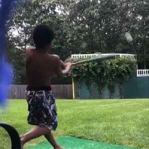 Kid hits a home run during his wiffle ball game, celebrates with epic bat flip [Video]