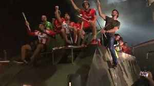 News video: Red Star Belgrade players ride on military vehicle to celebrate win