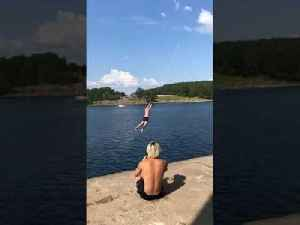 Guy Crashes Hard into Water After Rope Swinging From a Height [Video]