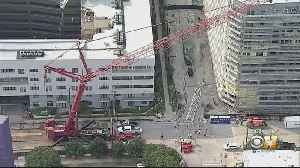 Collapsed Crane From June Storm Being Removed From Dallas Apartment Building [Video]