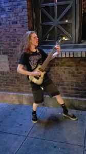 Guitarist Rocks From Outside the Venue [Video]