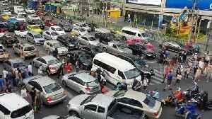 Cars cover zebra crossing during rush hour traffic in Bangkok [Video]