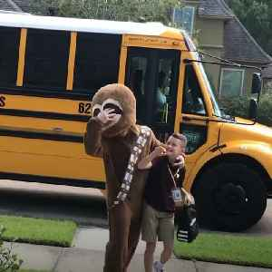 News video: Louisiana teenager greets younger brother at bus stop in outrageous costumes