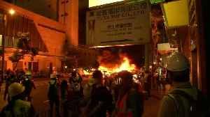 Barricade burnt as Hong Kong protest heats up [Video]