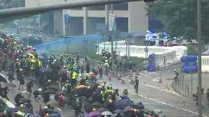 Hong Kong police fire blue-dyed water from water cannon [Video]
