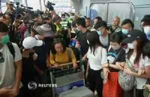 Protesters rally at Hong Kong airport [Video]